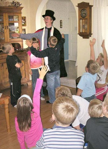 Magician casts spell on small children.