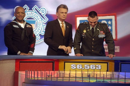 Game show contestants showing no embarrassment.